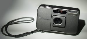 Photography of metalic looking point and shoot camera