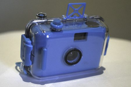 Blue waterproof point and shoot film camera in case